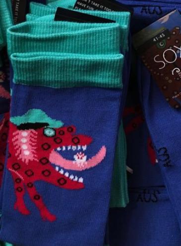 В одесском музее выпустили носки с репродукциями картин Примаченко, Ацманчука и «Козаком Мамаем»