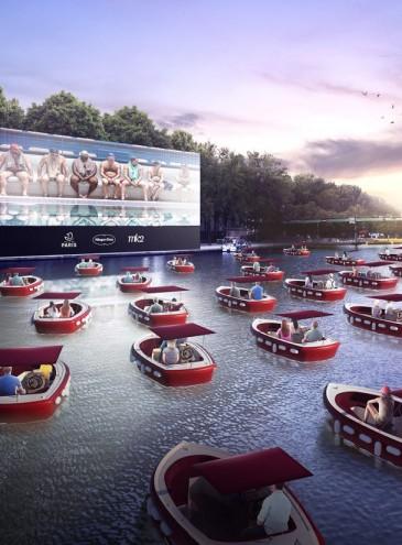 В Париже устроили кинотеатр на воде: зрители смотрят кино из лодок