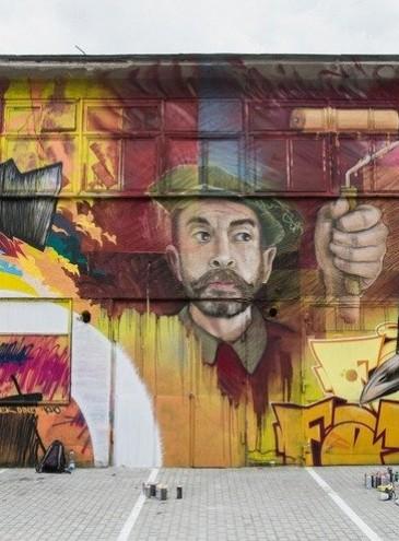 Во Львове на граффити-фестивале художники создали 80-метровый мурал на стенах старого цеха